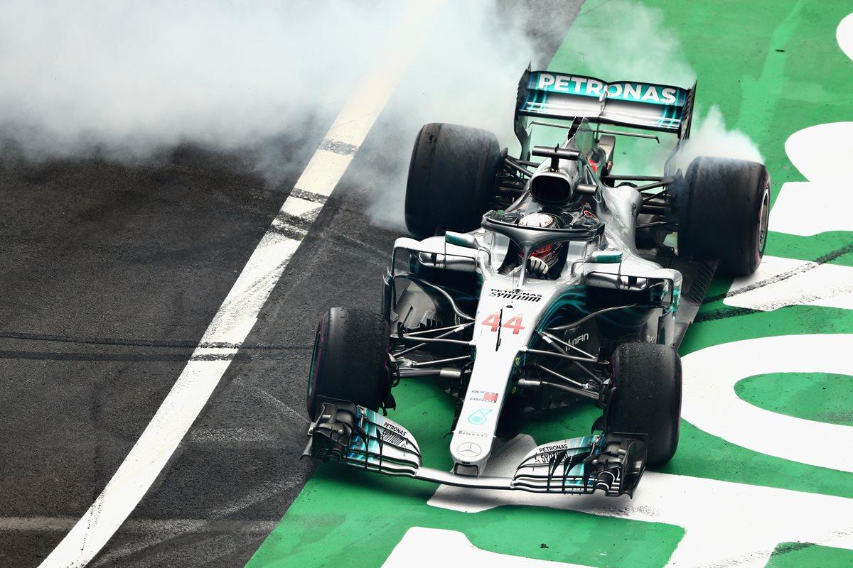 Lewis Hamilton ganó su quinto título de la Fórmula 1. (Foto Prensa Libre: AFP)