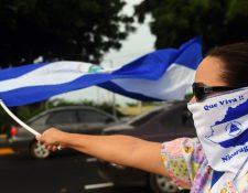 Activistas antigubernamentales participan en una manifestación exigiendo justicia para víctimas mortales en protestas.(AFP)