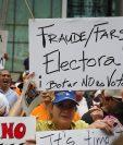 Protesta frente a la Embajada de Venezuela en Florida contra los comicios venezolanos en 2018. (Foto Prensa Libre: AFP)