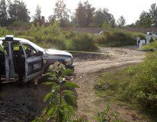 Los cadáveres de seis personas fueron encontrados este sábado en un lote baldío de la localidad de Tonalá, Jalisco. (Foto Prensa Libre: AFP)