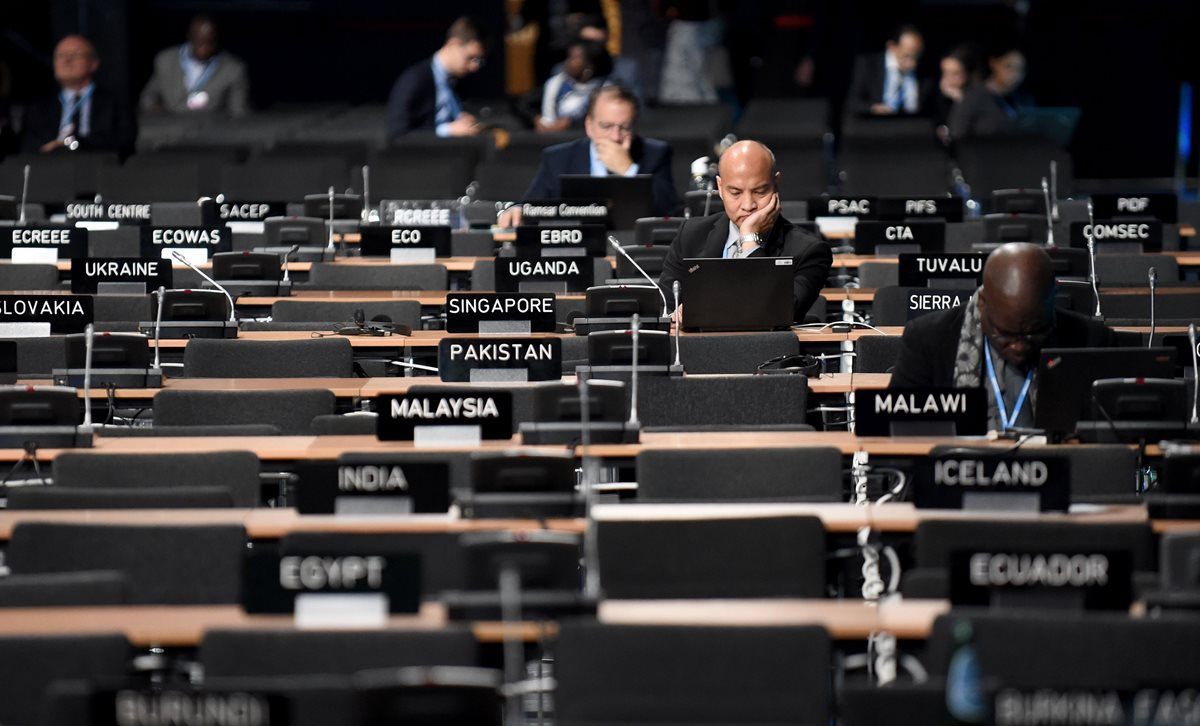 Invitados a la COP24 en una sala de trabajo en Katowice, Polonia. (Foto Prensa Libre: AFP)