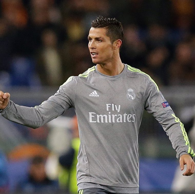 Real Madrid's Cristiano Ronaldo celebrates after scoring the opening goal   during a Champions League, round of 16, first-leg soccer match between Roma and Real Madrid, at the Rome Olympic stadium, Wednesday, Feb. 17, 2016. (AP Photo/Alessandra Tarantino)