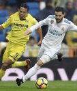 Nacho Fernández disputa el balón con Carlos Bacca durante el encuentro entre el Real Madrid y el Villarreal. (Foto Prensa Libre: AFP)