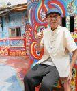 <em>El artista Huang Yung-fu que ha conquistado a turistas con su trabajo. (Foto Prensa Libre: AFP).</em>
