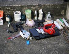 Parte de los ilícitos localizados por autoridades este martes en el Preventivo de la zona 18. (Foto Prensa Libre: PNC)