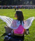 Una asistente al evento en el Central Park, en el corazón de Nueva York. (Foto Prensa Libre: AFP).