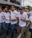 Líderes de la oposición venezonala y miles de seguidores saldrán el lunes a las calles para pedir la salida del presidente Nicolás Maduro. (Foto Prensa Libre: AFP)