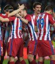 Los jugadores del Atlético de Madrid festejan contra el Málaga. (Foto Prensa Libre: AFP)