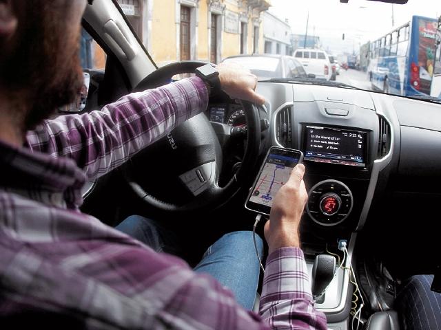 Excluyendo a Panamá, Uber tiene 30.000 socios conductores y cerca de un millón de usuarios en Centroamérica. (Foto Prensa Libre: Hemeroteca)