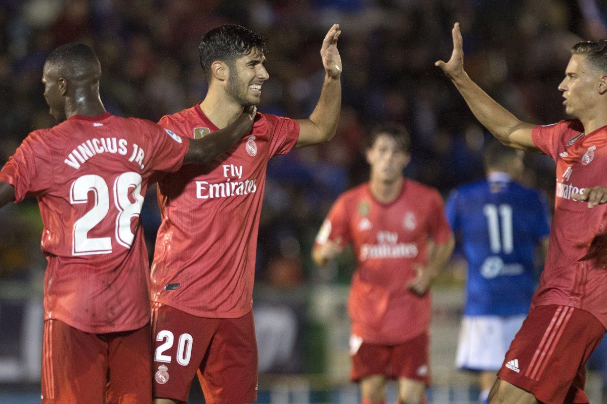 Marco Asensio celebra después de anotar en la victoria del Real Madrid 0-4 contra el Melilla. (Foto Prensa Libre: AFP)