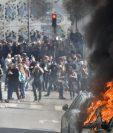 Manifestantes protestan contra la reforma laboral en París.(EFE).