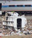 Las autoridades no han dado mayores detalles sobre el choque de tren contra un camión de basura en West Virgina, EE. UU. (Foto Prensa Libre: AFP)