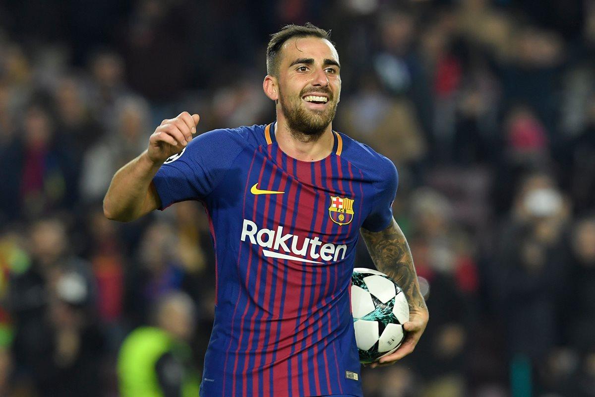 Paco Alcácer celebra el primer gol del equipo catalán contra el Sporting de Portugal. (Foto Prensa Libre: AFP)
