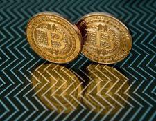 Los inversores aventureros ya han comprado la moneda virtual y Wall Street está sentando las bases para que fluya más riqueza en la criptomoneda. (Foto Prensa Libre: AFP)