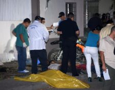 Los cinco jóvenes fueron asesinados en San Pedro Sula, Honduras. (Foto Prensa Libre: AFP).