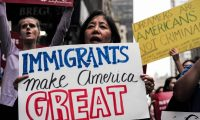 """(FILES) This file photo taken on October 05, 2017 shows protesters during a demonstration against US President Donald Trump during a rally in support of the Deferred Action for Childhood Arrivals (DACA), also known as Dream Act, near the Trump Tower in New York.Over 100 major US companies joined forces to urge Congress to protect immigrants brought to the country as children, signing a letter published in full-page ads in major newspapers on January 11, 2018. The companies called for immediate action to help workers who will lose the protection of the Deferred Action for Childhood Arrivals (DACA) program in March. Chief executives of Google, Facebook, Amazon and Apple -- together known as GAFA -- were joined by those from IBM, Microsoft, Coca-Cola, General Motors, AT&T, Marriott, Hilton and dozens of others signing the letter calling for protection for the """"Dreamers."""" / AFP PHOTO / Jewel SAMAD"""