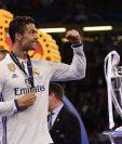 Cristiano Ronaldo porta con orgullo la medalla de campeón de la Champions. (Foto Prensa Libre: AFP)