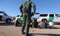 WALKER CANYON, AZ - MARCH 06: A U.S. Border Patrol agent guards a group of Mexican immigrants caught after they crossed into the United States on March 6, 2013 near Walker Canyon, Arizona. Due to broad federal sequestration budget cuts, Border Patrol agents are expected to begin taking unpaid furlough days in April, as Customs and Border Protection funding is expected to be reduced by more than $500 million.   John Moore/Getty Images/AFP== FOR NEWSPAPERS, INTERNET, TELCOS & TELEVISION USE ONLY ==