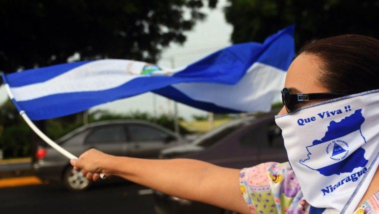 Opositores al gobierno de Ortega participan en una manifestación en Managua, Nicaragua. (AFP).
