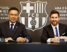 Josep María Bartomeu y  Lionel Messi  llegaron a un acuerdo de la reducción salarial de la plantilla. (Foto Prensa Libre: Hemeroteca PL)