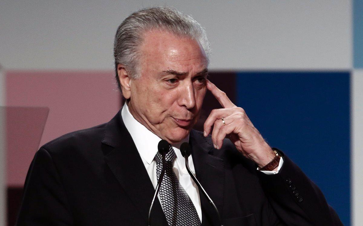 Michel Temer, presidente de Brasil, está en la cuerda floja. (Foto Prensa Libre: AFP)