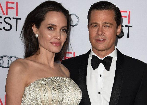 Angelina Jolie y su esposo Brad Pitt en el estreno de By the Sea. (Foto Prensa Libre: AFP)