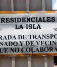 En Residenciales La Isla, zona 8 de Mixco, las personas que se resisten a pagar la cuota deben ingresan en el portón para transporte pesado. (Foto Prensa Libre: Oscar Felipe Q.)