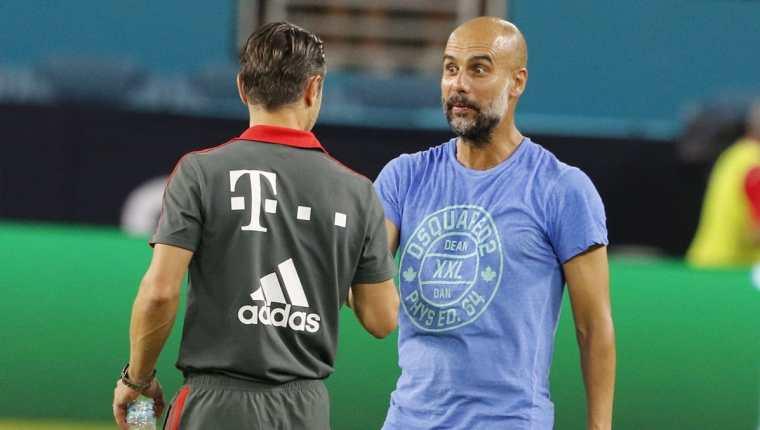 Guardiola saluda al técnico del Bayern Múnich, Niko Kovac, durante la International Champions Cup que se juega en Estados Unidos. (Foto Prensa Libre: EFE)