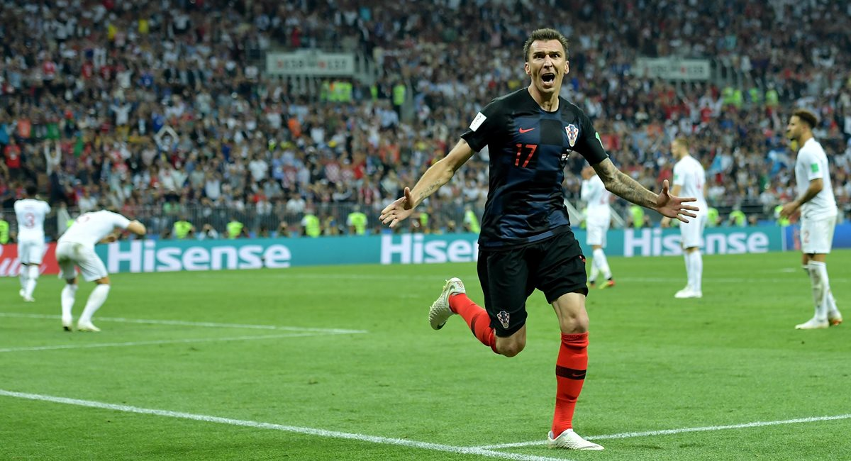 Moscow (Russian Federation), 11/07/2018.- Mario Mandzukic of Croatia celebrates scoring the 2-1 lead during the FIFA World Cup 2018 semi final soccer match between Croatia and England in Moscow, Russia, 11 July 2018.  (RESTRICTIONS APPLY: Editorial Use Only, not used in association with any commercial entity - Images must not be used in any form of alert service or push service of any kind including via mobile alert services, downloads to mobile devices or MMS messaging - Images must appear as still images and must not emulate match action video footage - No alteration is made to, and no text or image is superimposed over, any published image which: (a) intentionally obscures or removes a sponsor identification image; or (b) adds or overlays the commercial identification of any third party which is not officially associated with the FIFA World Cup) (Croacia, Mundial de Fútbol, Moscú, Inglaterra, Rusia) EFE/EPA/PETER POWELL EDITORIAL USE ONLY