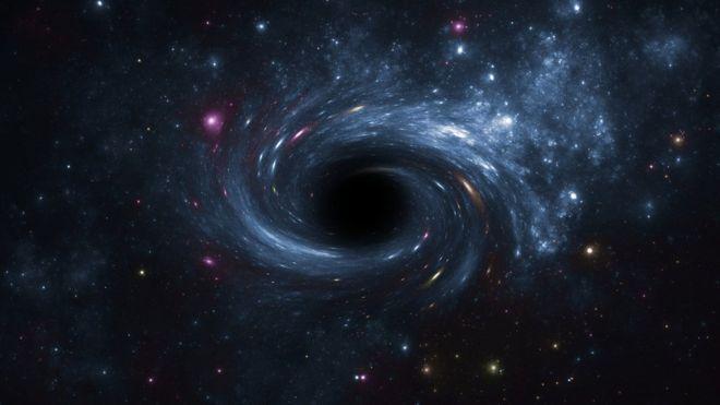 Recreación de un agujero negro rodeado de astros luminosos. GETTY IMAGES