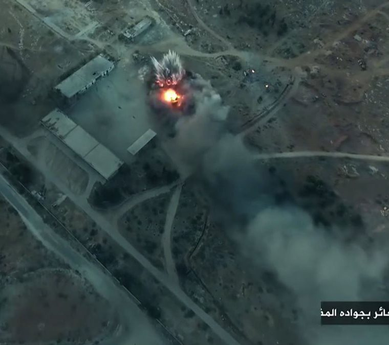 """An image grab taken from a video released on August 6, 2016 by Fateh al-Sham Front, the former Al-Nusra Front, which renamed itself after renouncing its status as Al-Qaeda's Syrian affiliate, shows a still from drone footage of smoke billowing from an artillery school south of Aleppo as Islamist rebels captured two military academies and a third military position.A Syrian coalition of jihadists and Islamist rebels seized key positions south of Aleppo as they press a major offensive to break the government siege of the city, a monitor said. / AFP PHOTO / FATEH AL-SHAM FRONT / STRINGER / == RESTRICTED TO EDITORIAL USE - MANDATORY CREDIT """"AFP PHOTO / FATEH AL-SHAM FRONT"""" - NO MARKETING NO ADVERTISING CAMPAIGNS - DISTRIBUTED AS A SERVICE TO CLIENTS FROM ALTERNATIVE SOURCES, AFP IS NOT RESPONSIBLE FOR ANY DIGITAL ALTERATIONS TO THE PICTURE'S EDITORIAL CONTENT, DATE AND LOCATION WHICH CANNOT BE INDEPENDENTLY VERIFIED  /"""