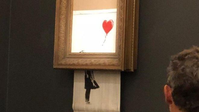 La obra de Banksy se autodestruyó tras ser vendida en una subasta. (SOTHEBY'S)