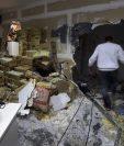 Desconocidos causaron daños en el diario Tiempo Argentino en Buenos Aires. (AFP).