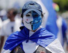 """Nicaraguenses se unen en la marcha """"Rescatemos la patria"""" (Foto Prensa Libre: EFE)"""