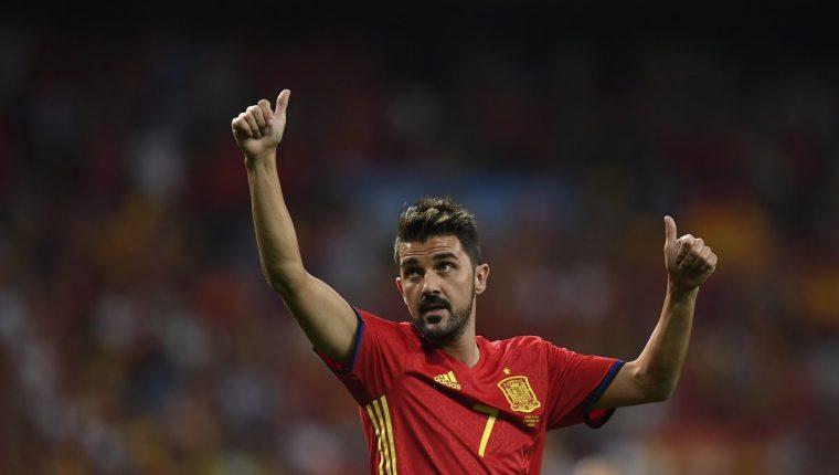 David Villa festeja el triunfo de España contra Italia, en un partido que marcó su regreso a la selección. (Foto Prensa Libre: AFP).