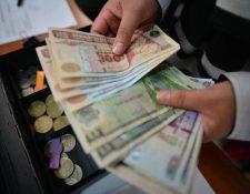 El dinero en circulación en la economía alcanzará los Q57 mil 200 millones en julio por el pago de los programas sociales de apoyo económico y el bono 14 a los trabajadores del sector público y privado. (Foto Prensa Libre: Hemeroteca)