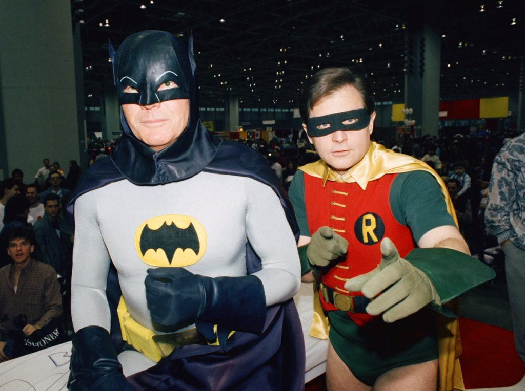 "FILE - In this Jan. 27, 1989 file photo, actors Adam West, left, and Burt Ward dress as their characters Batman and Robin respectively during an appearance at the ""World of Wheels"" custom car show in Chicago. The actors are voicing their characters in an animated film, ""Batman: Return of the Caped Crusaders,"" that will be released digitally on Oct. 11 and on Blu-ray on Nov. 1. (AP Photo/Mark Elias, File)"