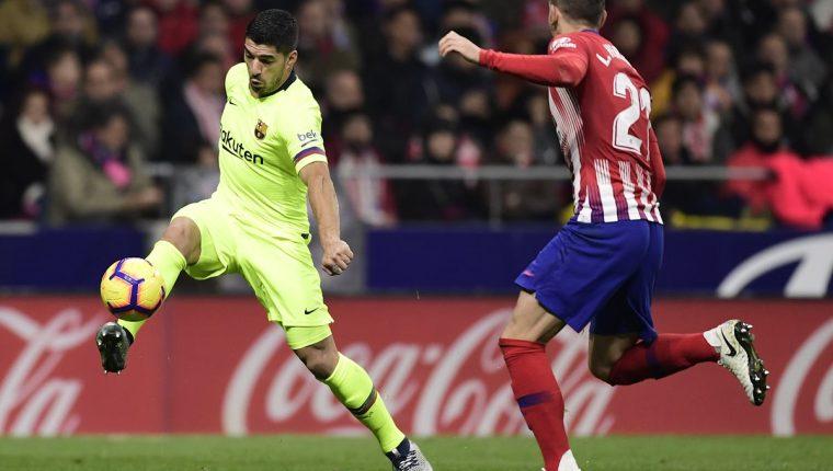 El delantero uruguayo Luis Suárez se pierde el partido contra el PSV por la Liga de Campeones de Europa. (Foto Prensa Libre: AFP)