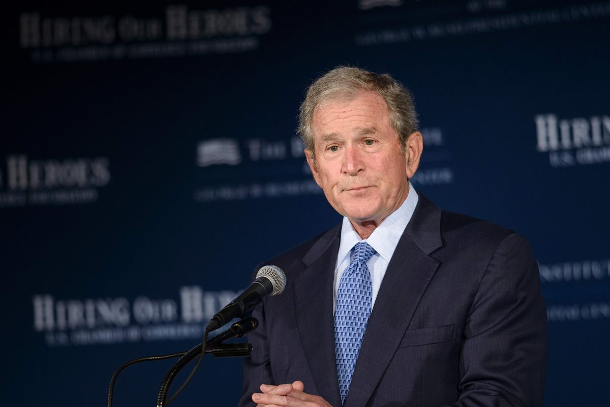 (FILES) This file photo taken on June 24, 2015 shows former US President George W. Bush at the US Chamber of Commerce in Washington, DC. America's most prominent Republican family, the Bushes, are declining to endorse Donald Trump for president, handing the GOP presumptive nominee an early setback in his efforts to unite a fractured party. Former presidents George W. Bush and George H.W. Bush, who undoubtedly bristled at Trump's bullying attacks on candidate Jeb Bush, signaled through their offices that they will stay on the sidelines during this cycle. / AFP PHOTO / BRENDAN SMIALOWSKI