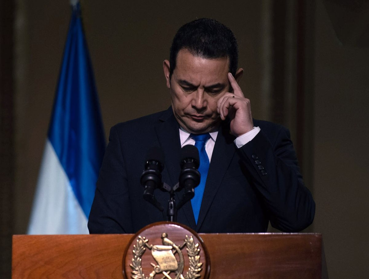 El discurso del presidente Jimmy Morales fue tibio ante la aplicación de las políticas migratorias de Donald Trump, según expertos. (Foto Prensa Libre: EFE)