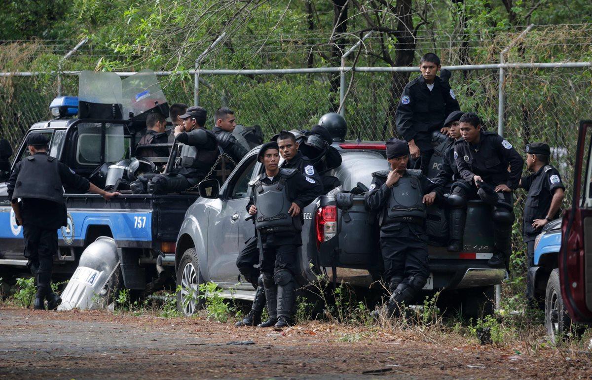 Informe revela que la Policía y grupos paralelos usaron armas contra manifestantes. (Foto Prensa Libre: AFP)