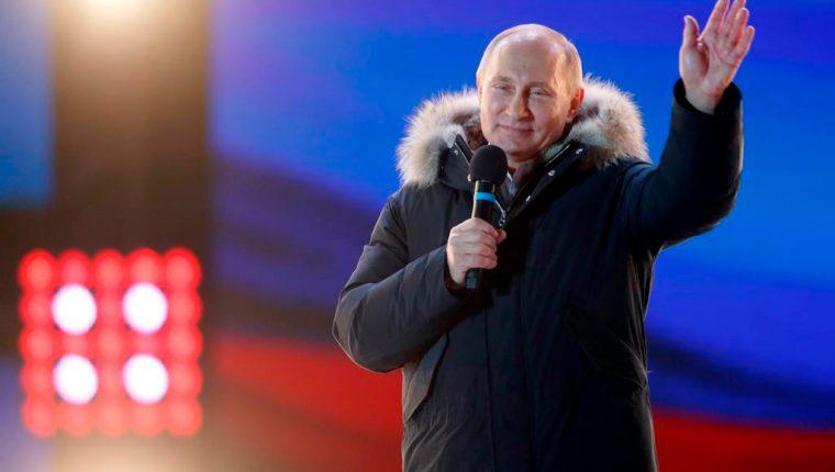 Vladimir Putin gana las presidenciales para continuar con su cuarto mandato. (Foto Prensa Libre: EFE)
