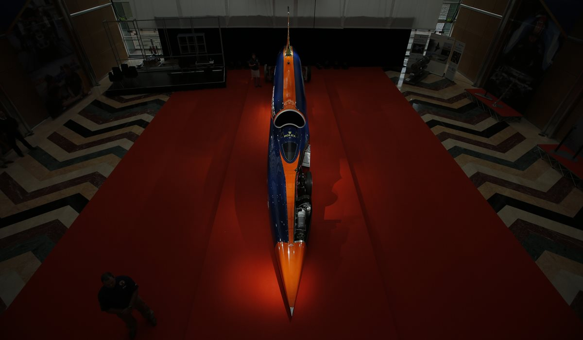 The British backed Bloodhound SSC streamliner car, designed to reach speeds of 1000 miles per hour (1609 kilometers per hour), is displayed to the media prior to being show to members of the public, London, Thursday, Sept. 24, 2015. The project aims to make high speed runs in South Africa in 2016, with a view to breaking the 1000 miles per hour (1609 kilometers per hour) in 2017. The car will use a Rolls-Royce EJ200 fighter jet engine and a Nammo rocket to achieve the required velocity. (AP Photo/Alastair Grant)