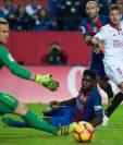 Ter-Stegen y Umtiti durante un partido de la Liga Española. (Foto Prensa Libre: AFP)