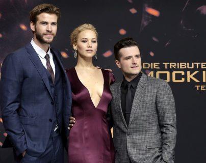 Actores Liam Hemsworth, Jennifer Lawrence y Josh Hutcherson, durante el preestreno en Berlín, Alemania. (Foto Prensa Libre, AP)