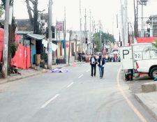 El ataque armado fue en el bulevar el Milagro frente al 36-38, zona 6 de Mixco. (Foto Prensa Libre: Erick Ávila).
