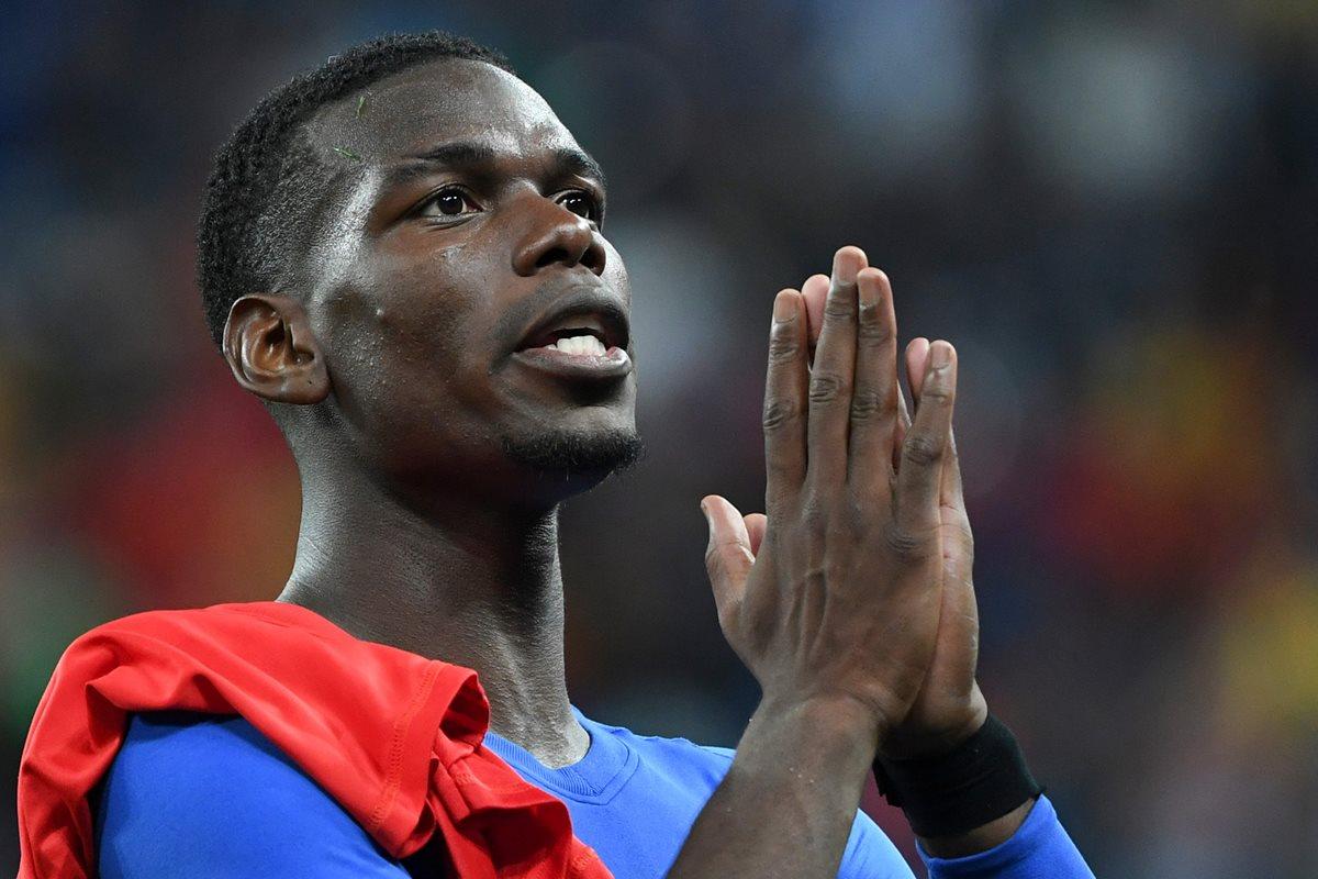 Paul Pogba se ha caracterizado por mandar mensajes de apoyo cuando suceden tragedias o casos como el de los Jabalíes Salvajes. (Foto Prensa Libre: AFP)