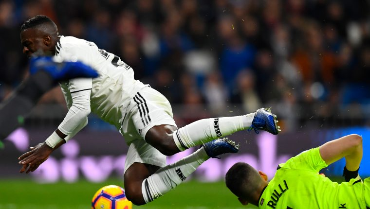 Real Madrid's Brazilian forward Vinicius Junior falls down during the Spanish League football match between Real Madrid CF and Real Sociedad at the Santiago Bernabeu stadium in Madrid on January 6, 2019. (Photo by GABRIEL BOUYS / AFP)
