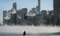 CHICAGO, ILLINOIS - JANUARY 30: A man takes a picture along the lakefront as temperature hung around -20 degrees on January 30, 2019 in Chicago, Illinois. Businesses and schools have closed, Amtrak has suspended service into the city, more than a thousand flights have been cancelled and mail delivery has been suspended as the city copes with record-setting low temperatures.   Scott Olson/Getty Images/AFP == FOR NEWSPAPERS, INTERNET, TELCOS & TELEVISION USE ONLY ==