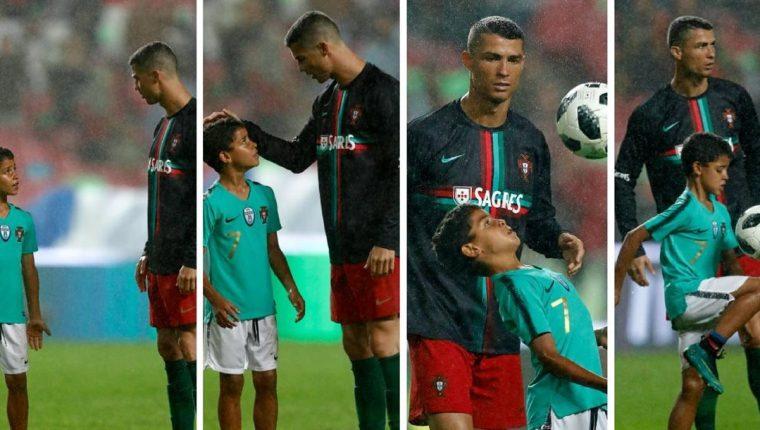 Cristiano Ronaldo y su hijo conversan sobre la gramilla del Estadio Da Luz, en Lisboa, luego del triunfo de Portual 3-0 sobre Algeria. (Foto Prensa Libre: EFE)